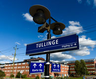 Tullinge train station with the station sign. Tullinge, Sweden - August 12, 2015: Tullinge train station with the station sign, speaker, sign show exit direction Stock Photo