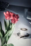 Tullips and coffee Stock Photos