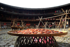 Tulou Life. Fujian Tulou are usually a large building, most commonly rectangular or circular or square in configuration, with very thick load-bearing rammed Royalty Free Stock Photos