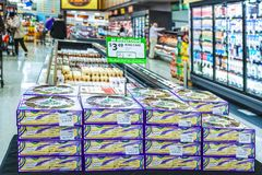Boxed Kings Cakes stacked up in grocery market for sale near Mardi Gas stock image