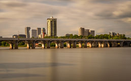 Tulsa Skyline. Sunset skyline of Tulsa, Oklahoma with Arkansas river in the foreground. Long exposure Stock Photography