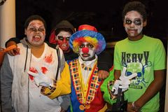Tulsa USA Four African American boyss in zombie face paint and one dressed like a clown givng two peace signs trick or treat on Ha stock photos
