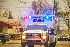 2-1-2019 Tulsa USA - Oncoming EMSA ambulance with lights blazing on urban street on overcast day - selective focus stock image