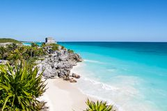 Tulum beach. Beautiful beach with turquoise water in Tulum Mexico, Mayan ruins on top of the cliff stock images