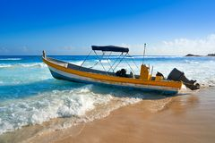 Tulum Caribbean beach boat in Riviera Maya. Tulum Caribbean turquoise beach boat in Riviera Maya of Mayan Mexico stock photo