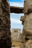 Tulum Mayan temple. The main Mayan temple at Tulum in Mexico, view through gap in stone wall Stock Image
