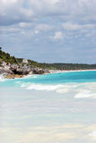 Tulum Mexico beach photo. Beach near Tulum Mexico with long view to ruins Royalty Free Stock Photos