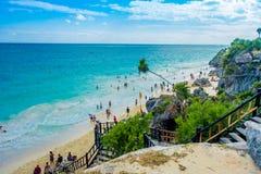 TULUM, MEXICO - JANUARY 10, 2018: Above view of unidentified enjoying the beautiful view close to the Mayan Ruins of. Tulum Besides Caribbean Sea. Riviera Maya stock image