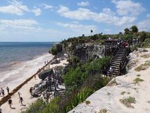 Wooden staircase of vantage point at seaside landscape at TULUM city in Mexico near archaeological site with tourists royalty free stock photo