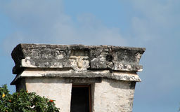 Tulum precolumbian temple ruins. Ancient Maya temple ruins at Tulum archaeological park in Yucatan, Mexico. closeup showing details such as upside down god Stock Photo