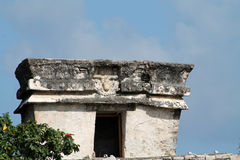Tulum precolumbian temple ruins. Ancient Maya temple ruins at Tulum archaeological park in Yucatan, Mexico. closeup showing details such as upside down god Royalty Free Stock Image