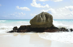 Tulum rock on beach. Large rock sitting on beautiful beach in tulum mexico Royalty Free Stock Images