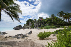 Tulum ruins and beach. View of the ruins of Tulum from the beautiful beach above the rocks Royalty Free Stock Photography