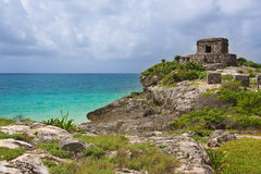 Tulum ruins of God of winds mayan temple on a cliff overlooking Royalty Free Stock Images