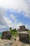 Tulum ruins of Offertories and God of winds mayan temple. Ruins of God of winds mayan temple on a cliff overlooking blue torquoise ocean in Tulum Quintana Roo stock photography