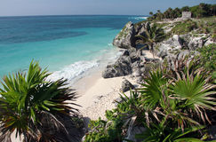 Tulum ruins with sandy beach. Watching the sandy beach and Tulum ruins from a rock. Tulum. Yucatan. Mexico stock photos