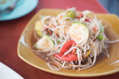 Tum Sua, Papaya Salad with Vermicelli, selective focus. Tum Sua, Papaya Salad with Vermicelli, Salted Crab and Fermented Fish, Traditional Thai Food, selective Royalty Free Stock Images