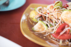 Tum Sua, Papaya Salad with Vermicelli, selective focus. Tum Sua, Papaya Salad with Vermicelli, Salted Crab and Fermented Fish, Traditional Thai Food, selective royalty free stock photo