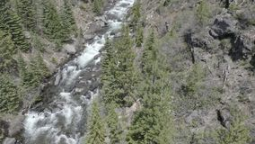 Tumalo Falls 05-24-19. Tumalo Falls is a 97-foot waterfall on Tumalo Creek, in the Cascade Mountain Range west of Bend in the U.S. state of Oregon. And is within stock video