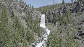 Tumalo Falls 05-24-19. Tumalo Falls is a 97-foot waterfall on Tumalo Creek, in the Cascade Mountain Range west of Bend in the U.S. state of Oregon. And is within stock footage
