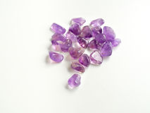Tumbled Amethyst stones close up for crystal therapy treatments Stock Images