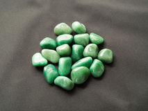 Tumbled aventurine stones for crystal therapy treatments and rei Stock Photo
