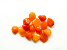 Tumbled carnelian stones on white background for crystal therapy Stock Image