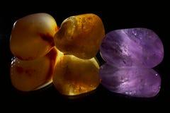 Tumbled gemstones on a black mirror royalty free stock photos