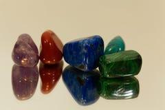 Tumbled gemstones on a mirror Stock Image