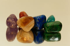 Tumbled gemstones on a mirror Stock Photography