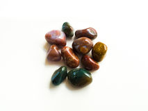 Tumbled jasper stones for crystal therapy treatments and reiki d royalty free stock photography