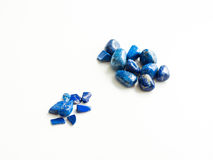 Tumbled lapis lazuli Quartz stones close up for crystal therapy Royalty Free Stock Photography