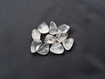 Tumbled Pink Quartz stones close up on black cloth for crystal t Stock Photo