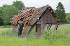 Tumbledown barn on a field. Tumbledown barn on the farmers field Royalty Free Stock Image