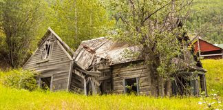 A tumbledown dwelling a telegraph creek. A collapsed, rotting house as seen in northern canada Stock Image