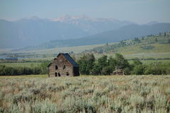 A tumbledown log cabin in the mountains. An abandoned countryside house in idaho Royalty Free Stock Image