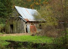 Tumbledown shack. A wooden and tine tumbledown shack in Vitre France Stock Images