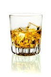 Tumbler of brandy and ice Stock Image