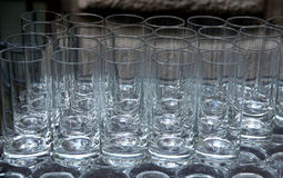 Tumbler glasses on grey surface Stock Image