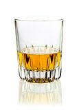 Tumbler of whisky or brandy. Tumbler of golden whisky or brandy served neat on a white studio background with reflection Royalty Free Stock Photos