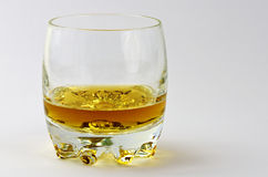 Tumbler with whisky. Tumbler partly filled with amber-coloured whisky Stock Photo