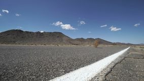 Tumbleweed Blows Across A Road in the Desert 2 of 2 stock video footage