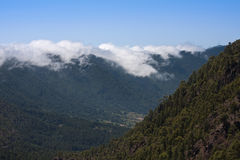 Tumbling clouds over a mountain ridge. La Palma, Canary Islands royalty free stock photos