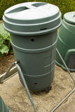 Tumbling Composter. A tumbling Composter used by gardeners to produce compost in as little as 2 weeks Royalty Free Stock Photos