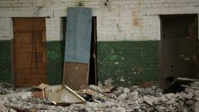 Tumbling door. In an abandoned derelict buildings stock video footage