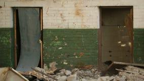 Tumbling door. In an abandoned derelict buildings stock footage