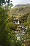 Tumbling Mountain Stream. Stream tumbling down from Lake Idwal,  Ogwen Cottage, the Nant Ffrancon Valley, Gwynedd, Wales, United Kingdom Stock Image