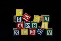 Tumbling Stack of Alphabet blocks Royalty Free Stock Images