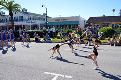 Tumbling in the street. VENICE, FL - OCTOBER 18: A group of girls perform gymnastics jumps and tumbles as part of the the Annual Venice Sun Fiesta parade on stock photography