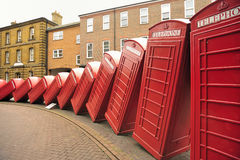 Tumbling telephone boxes, Old London road Royalty Free Stock Image